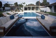 A mid-century house designed by architect William Cody, Palm Springs, WOW i love the pool seats .