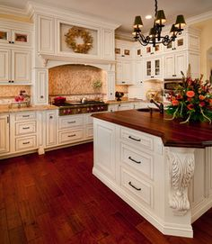 Jeff King, Designer, Kitchen Places, Ventura, CA. Inset construction, Maple wood, Soft Cream finish. Photography: Schaf Photo ***Love the wood floor color with the white cabinets.