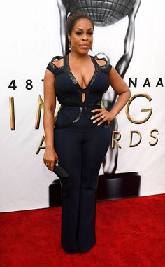 Niecy Nash from 2017 NAACP Image Awards: Red Carpet Arrivals  A traditional pantsuit takes a sultry turn with edgy cutouts and sequins on theScream Queen star.