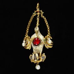This jewel is 'The Pelican in her Piety pendand' (about 1550-75). The pelican feeding her young with blood from her breast is a symbol of Christ. It was associated with Elizabeth as mother of her nation and the queen owned several pelican jewels set with rubies or garnets.