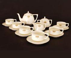 Earthenware tea service teapot sugarbasin milkjug and 6 cups saucers white mat-glaze with polychrome linear rim-decoration decor no.290 design Klaas Vet ca.1915 executed by Arnhem Arnhemsche Fayencefabriek the Netherlands