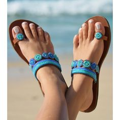 Mabha Blue Toe Loop Sandals. £50. This sophisticated style features a pattern of pretty beads on a tan leather upper. Worldwide Shipping Available.