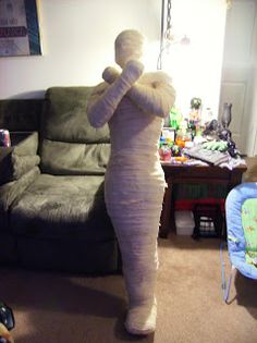 Crafty Mummy and Me: complete tutorial on how to make a life size mummy. Lots of duct tape, stuffing material and cheesecloth strips!