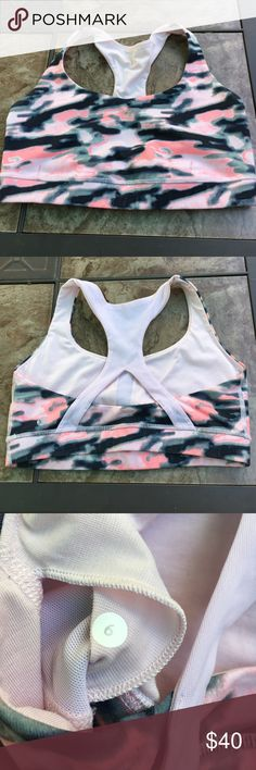 Lululemon sports bra Pink camo lululemon sports bra. Gently used a couple times so nothing is wrong with it, I just never reach for it anymore. I don't remember the name of this one but the cross straps across the back are a mesh feel. Comfortable and in great condition. There's openings for pads but I no longer have them. lululemon athletica Tops