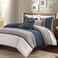 Give your bedding an update with the Madison Park Palisades Reversible Comforter Set. The soft, microsuede comforter set is decorated with horizontal stripes of heather grey, navy blue, and charcoal grey, adding a casual, stylish look to your bedroom.