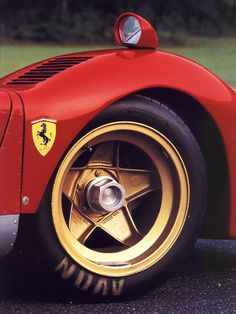 Ferrari.  Classic gold Campagnolo wheels; has to be a Ferrari; the 512 LM here.