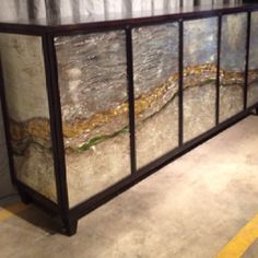 Simply stunning!  This handmade 5 door buffet from CR Currin  incorporates original artwork into the glass door panels to create movement across the piece.  Its like jewelry for your dining room.  If you're looking for a one of a kind statement piece - this is it! 505 Aztec Drive