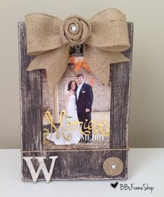 Handmade distressed wooden picture frame with burlap bow, initials and rosettes on Etsy, $30.00
