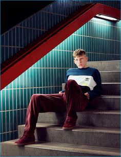 Connor Newall pictured in a colorblocked sweatshirt for Adidas' fall-winter 2016…