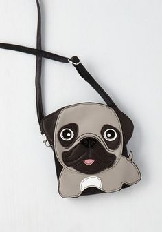 This little animal bag will help you scurry up the style ladder! Touting a crossbody strap, plentiful pockets, and white, and black vegan faux leather shaped like a Pug, this fun purse is quirky, charming, and practically 'pet-able'!