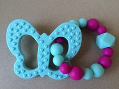 A personal favorite from my Etsy shop https://www.etsy.com/ca/listing/482753317/baby-teething-butterfly-silicone