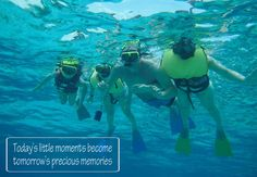 A family snorkels together  - a great portrait for the wall - and a great memory for forever - Grand Cayman snorkel tours