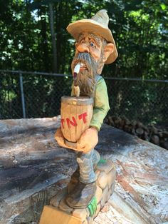 """Wood carving """"Bomb Squad"""" by Dwayne Gosnell"""