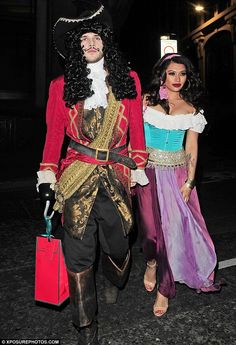 Across the board: Vanessa White showed off her ample cleavage to Esmeralda, while her boyfriend dressed as Captain Hook