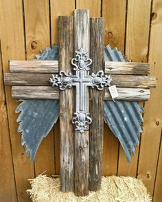 Triple wooden Cross, with cast Iron Cross, and corrugated metal angel wings. 34 tall and 25 wide. Made from reclaimed fence Wooden Cross Crafts, Wooden Crosses, Crosses Decor, Wall Crosses, Metal Crafts, Wooden Diy, Wood Crafts, Mosaic Crosses, Painted Crosses