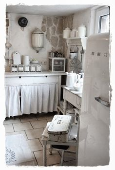 Vintage Rose Cottage - stone accent, cabinet curtains.  * Sustainable Design Innovation, Green Kitchen