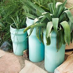 Even though terra cotta seems like the old standby in the garden, when used in an unusual shape it brings a new feeling to a tired space. These tubes are sunk in the ground, filled half way with rock and then with soil. Plant what you like and watch it take hold.