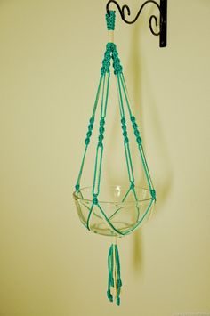It's back....Hand Crafted Macrame Plant Hanger- Turquoise and Vanilla. $8.99, via Etsy.
