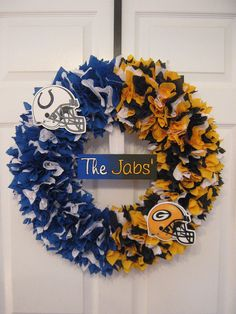 "18"" NFL house divided wreath with customizable center name plaque on Etsy, $50.00"