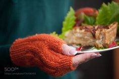 hands in orange mittens hold a plate with cake by marinamassel11  IFTTT 500px