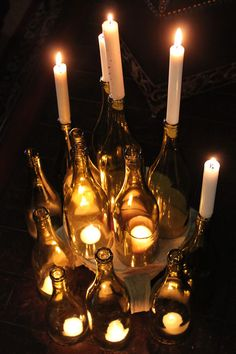 Cut Wine Bottles as Candle Holders - note that they are cut on different levels. that might be an interesting effect for center pieces.