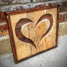 Approximately 12 X 12 X 3. Hand made with reclaimed pallet wood boards. Background layer stained or painted to your choice of color, foreground hand cut to the heart shape. Framed border.  Can be hung on a wall or propped on a shelf, mantel, countertop, etc.  When you place your order, message me your selections of: 1. Background color or wood stain shade (dark or light) 2. Border color or wood stain shade (dark or light)  Construction time is usually one week.  Thanks
