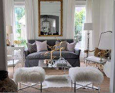 fuzzy white & chrome benches, gold accents anchored by a grey sofa.