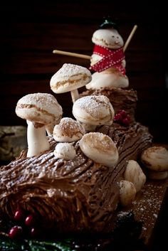 Yule log with meringue mushrooms and snowman