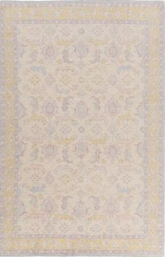 A traditional design in a soft palette make up this hand knotted Zahra rug from Surya (ZHA-4041).