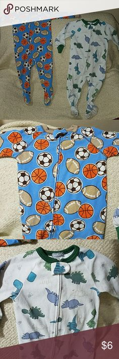 Footed pajamas 2 pairs of footed pajamas.  One is sports themed with footballs, basketballs and soccer balls.   Other one is dinosaur themed. Carter's Pajamas Pajama Sets