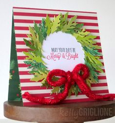 This card is a great way to spread Holiday cheer! The designer used our Top Dog Dies Leafy Branch Die and pieced together a wreath. How festive!