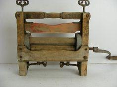vintage old antique wooden washing machine wringer has advertising on it