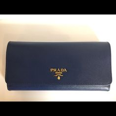 fae4bf49977b Authentic Prada wallet w  ID case Dark blue saffiano leather with gold  hardware. BNWB