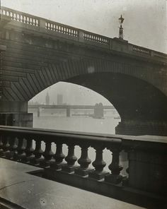 View under Waterloo Bridge towards Hungerford Bridge, Westminster Bridge, & Palace of Westminster, c. 1910