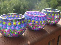 Candle holders decorated with vibrant-colored polymer clay cane slices.