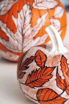 Freehand leaf shapes with a Sharpie for this playful pumpkin decoration.