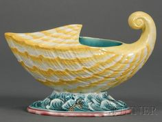 Wedgwood Majolica Spoon Warmer, England, c. 1879, polychrome decorated shell form on a wave molded base.