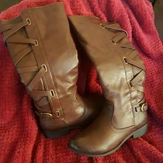 Adorable Brown Boots Super cute and stylish boots with criss cross strap that buckles at the bottom!! Zip side. Never worn! Reposh due to my foot being too wide! ???? Jst trying to get what I paid for them! Shoes Winter & Rain Boots
