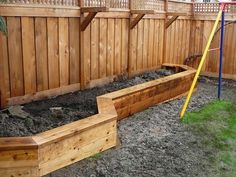 Raised planter box along fence that doubles as a bench. Also brackets for hanging plants  Want this for our new house