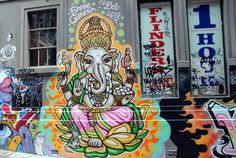 Shree Ganesh Graffiti – Melbourne, Australia    If you have ever been to Sydney and then Melbourne, you know that Melbourne is the artsy sub-culture laden city while Sydney stands tall with all of its natural beauty and world famous sights. Before traveling to Melbourne, I had read about the street art in Melbourne and when we stumbled upon an amazing complete alley way of vibrant graffiti, we snapped this shot ...