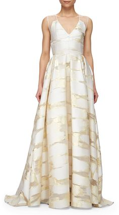 Lela Rose metallic golden space-dyed satin gown.Deep V neckline.Sleeveless; moderate shoulder coverage.Sheer back.Seam at natural waist.Box-pleated full skirt falls to floor.Fitted silhouette.Polyester/silk.Made in USA of Italian materials.