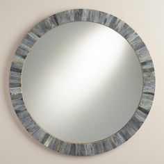 Bordered with natural bone tiles in a chic blend of tonal grays, our round mirror brings visual texture and depth to any space.