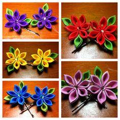 Kanzashi flowers on hair pins.