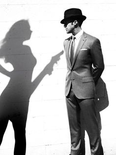:) Shadows and mystery. And a classically cut suit.