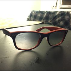 Wayfarer Ray Bans. Navy blue and orange. In good condition, minor scuff on left lens Ray-Ban Accessories Sunglasses