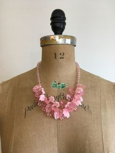 A personal favorite from my Etsy shop https://www.etsy.com/listing/606390069/1980s-pink-lucite-bead-leaves-necklace
