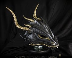 Black and Gold Dragon Helmet by Azmal.deviantart.com on, heres the helmet to go with the armor