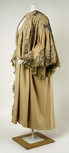 House of Worth, evening wrap, French, 1905. Wool with metallic thread embroidery, floral-patterned lace, chiffon, tulle, beads, and rhinestones. Side view. MMA Collections.
