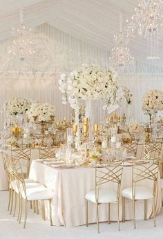 What's more elegant than a white and gold wedding under a white tent ~ https://www.insideweddings.com/weddings/elegant-all-white-country-club-wedding-with-natural-greenery/530/