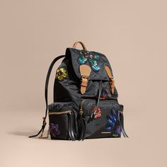 Burberry The Large Rucksack in Technical Nylon with Sequinned Flowers ($2,315) ❤ liked on Polyvore featuring bags, backpacks, flower backpack, pocket backpack, lightweight backpack, lightweight rucksack and sequin backpack